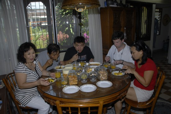 Aunty, Uncle, Colin-boy, Cols, and Mei Chin take a shift to eat