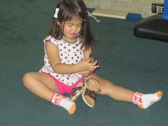 "Yaya puts her shoes on ""all by myself"""
