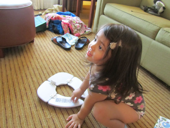 Playing with her potty seat