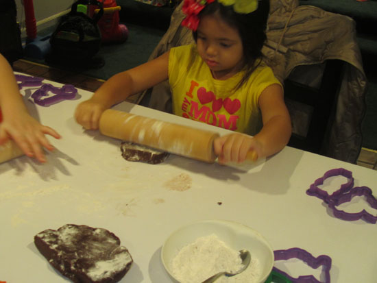 Yaya gives the rolling pin a try