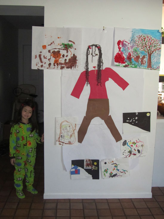 "Yaya poses next to her ""art wall"""