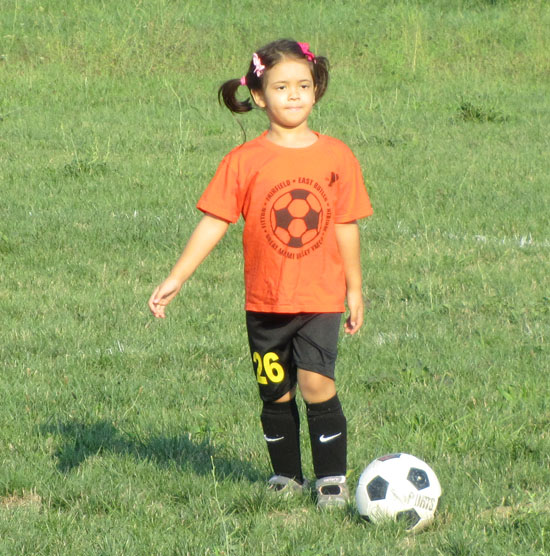 At soccer practise in last spring's team t-shirt