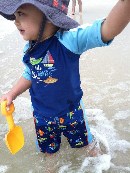 Adik wades in the surf