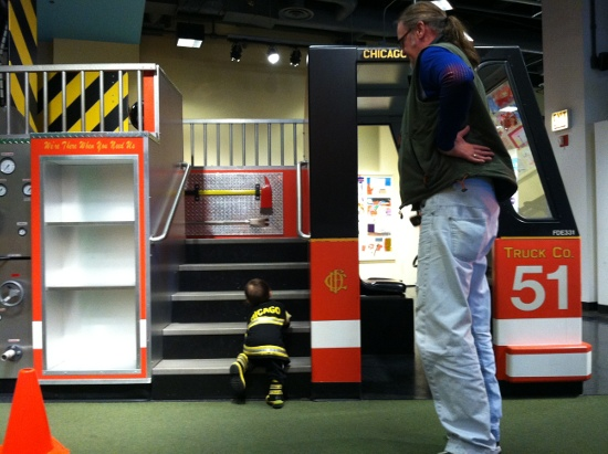 Fire truck stairs are a little steep for this little fireman