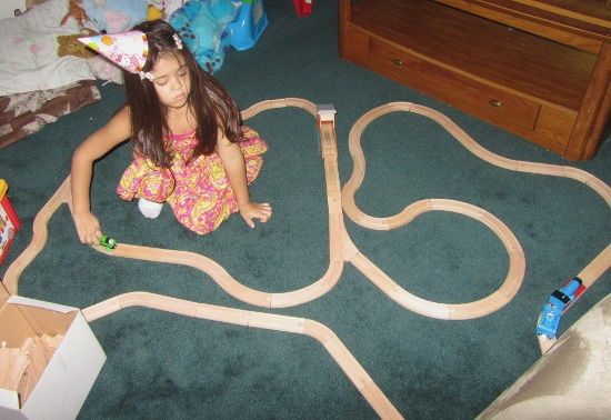Yaya loves her new train set