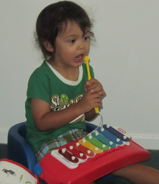 One man band - using the xylophone stick as his mike