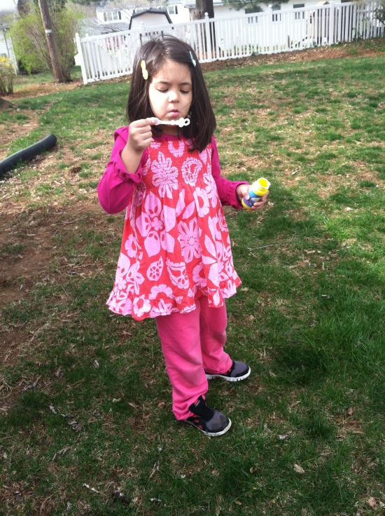 Blowing bubbles at Aunt Joan's