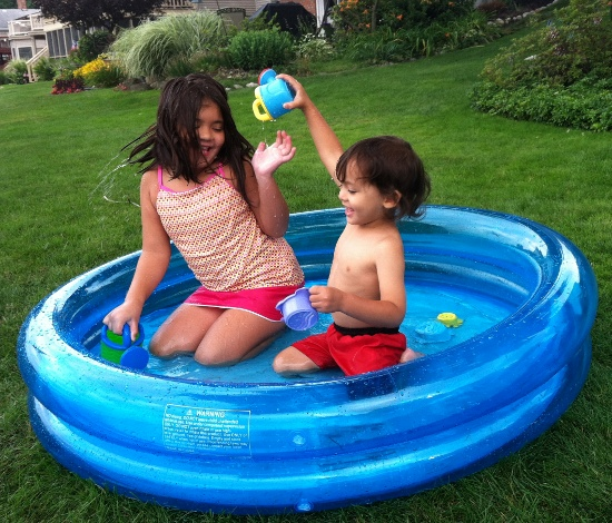 Playing in Olivia from next door's paddling pool