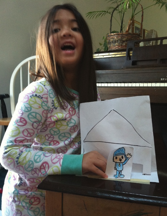 "Proudly showing off her ""paper mini"" Pocoyo"