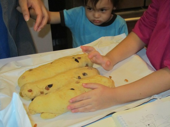 Adik is unhappy he can't keep playing with the dough