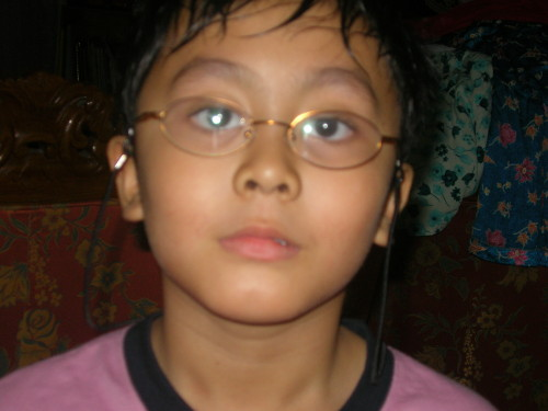 Irfan looks at camera with glasses on