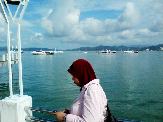 Surrounded by ships near the Kuah Jetty