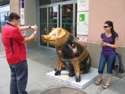 Taking pictures of pig sculptures