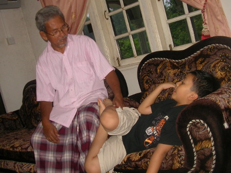 Tok Bah converses with his grandson