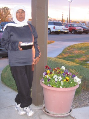Mak by a planter of pansies (I think)