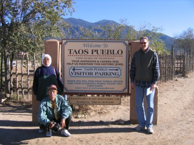 Mak, Abah and Vin by the Taos Pueblo sign