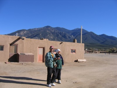 Mak and Abah by the adobe buildings of the pueblo