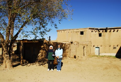 Mak and me by a building close to the entrance of the pueblo