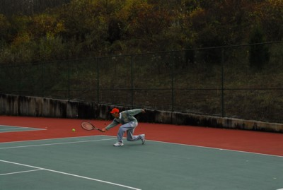 Reaching for a forehand