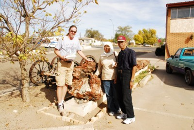 Vin, Mak and Abah by the petrified tree in Holbrook, AZ