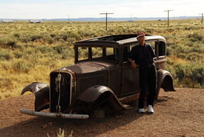 Abah by the antique car on Route 66