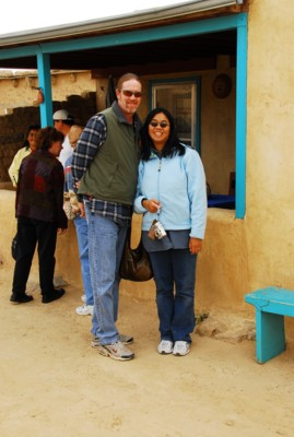 Vin and I by a traditional puebloan house