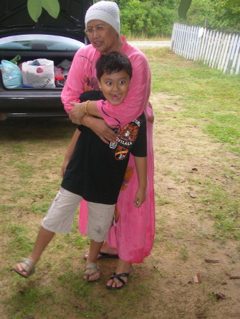Tok Ma hugs her grandson before he leaves for home