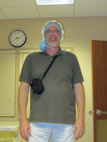 Vin starts to get dressed in scrubs