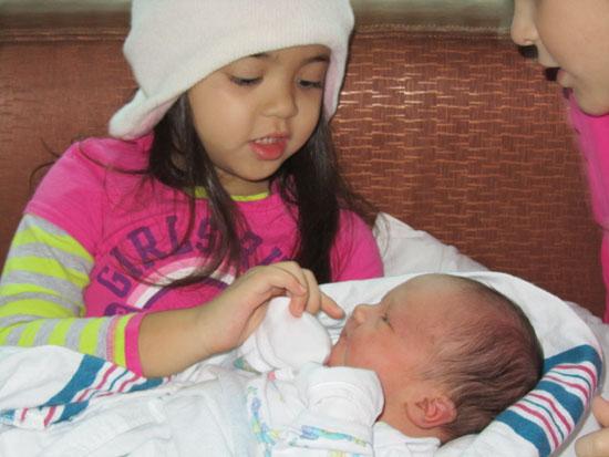 Kak Yaya gets to hold her Adik