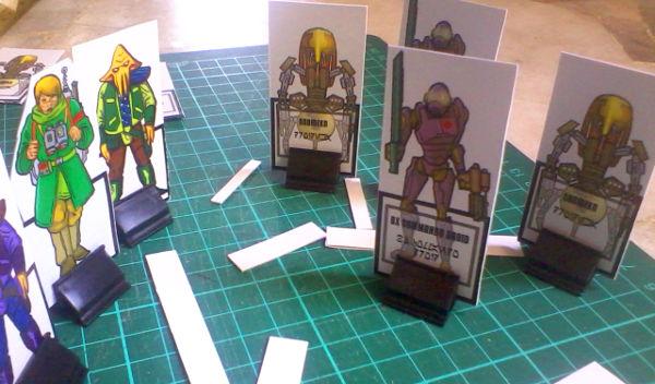 Sasha and two Quarrens meet some droids