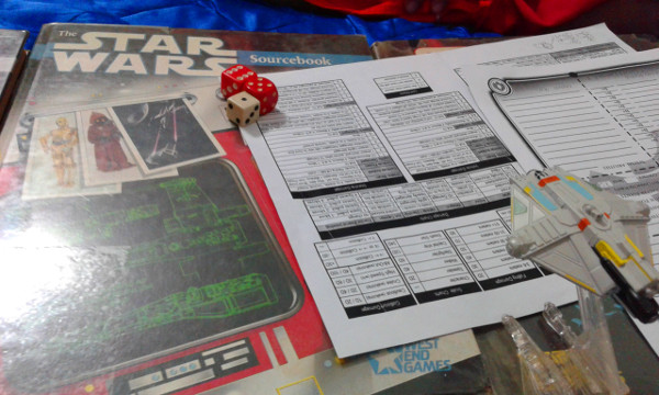 The Star Wars Sourcebook hardcover made a great dice rolling platform