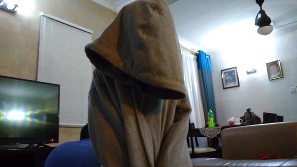 A cloaked figure